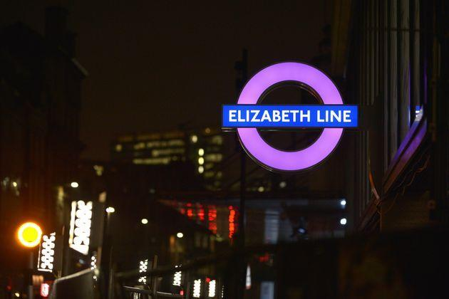 A new London Underground roundel for the Elizabeth Line is illuminated outside the new Crossrail station (Photo: Jim Dyson via Getty Images)
