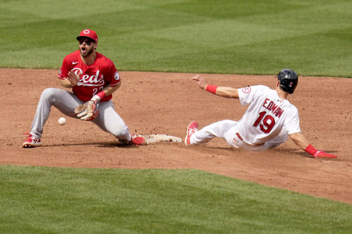St. Louis Cardinals' Tommy Edman (19) is safe at second for a stolen base as Cincinnati Reds shortstop Mike Freeman handles the throw during the sixth inning of a baseball game Sunday, June 6, 2021, in St. Louis. (AP Photo/Jeff Roberson)