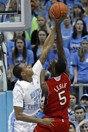 North Carolina's John Henson (31) blocks North Carolina State's C.J. Leslie (5) during the first half of an NCAA college basketball game in Chapel Hill, N.C., Thursday, Jan. 26, 2012. (AP Photo/Gerry Broome)