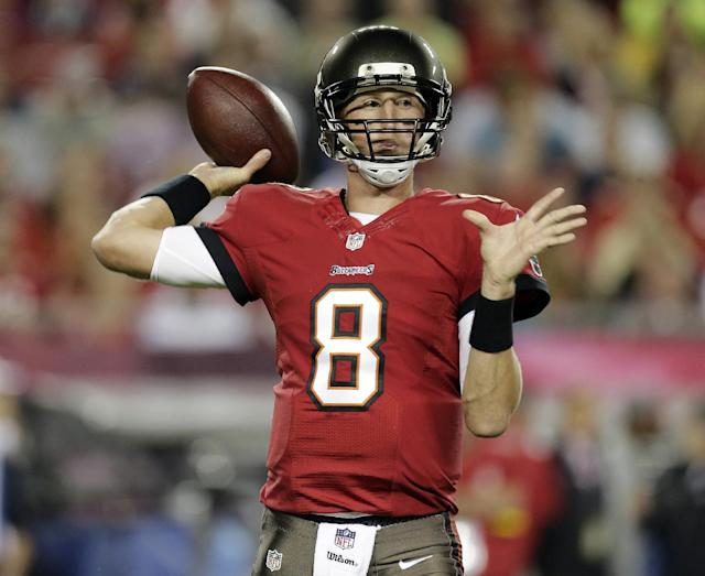 Tampa Bay Buccaneers quarterback Mike Glennon (8) throws a pass against the Carolina Panthers during the first quarter of an NFL football game on Thursday, Oct. 24, 2013, in Tampa, Fla. (AP Photo/Chris O'Meara)