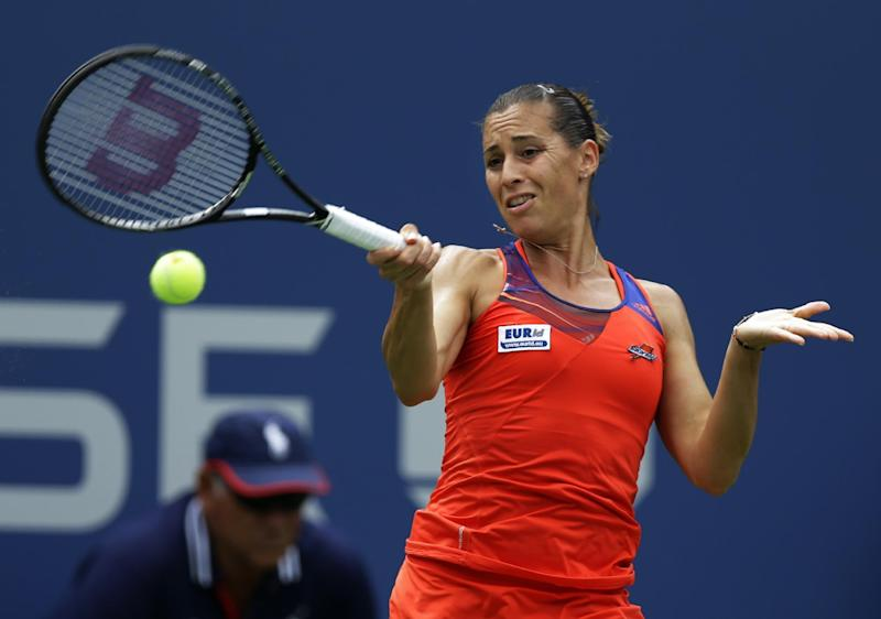 Flavia Pennetta, of Italy, returns a shot to Sara Errani, of Italy, during the second round of the 2013 U.S. Open tennis tournament, Thursday, Aug. 29, 2013, in New York. (AP Photo/Kathy Willens)