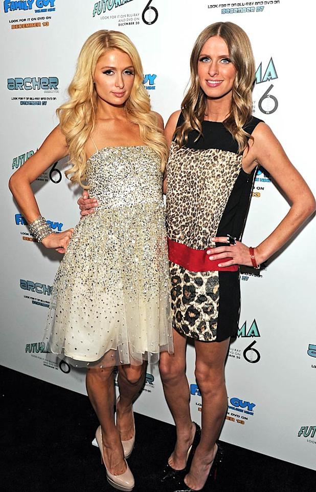 """Paris Hilton threw a Christmas shindig on Wednesday night at her home in the Hollywood Hills, and made sure to take a photo with her little sister Nicky. """"Most amazing house party ever! @DJAfrojack spinned the sickest set ever! Everyone had the time of their lives! So much fun! #YES!"""" tweeted the socialite. (12/07/2011)"""