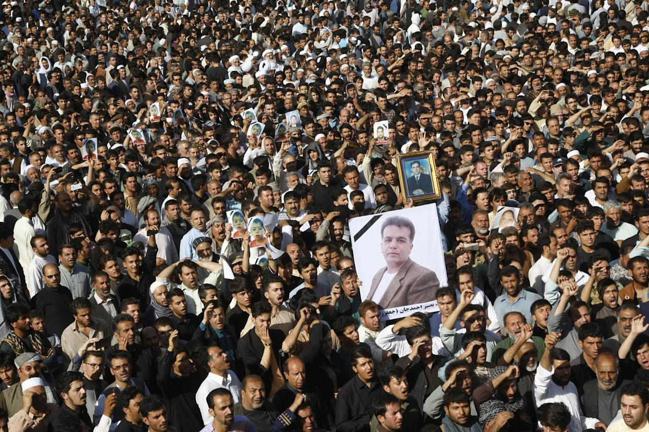 <p>Afghan people gather to stage a demonstration against Afghan Government due to increasing security issues as they carry photographs those who lost their lives on Tuesday evening after an assault to a mosque, in Herat, Afghanistan on August 02, 2017. (Photo: Mir Ahmad Firooz/Anadolu Agency/Getty Images) </p>