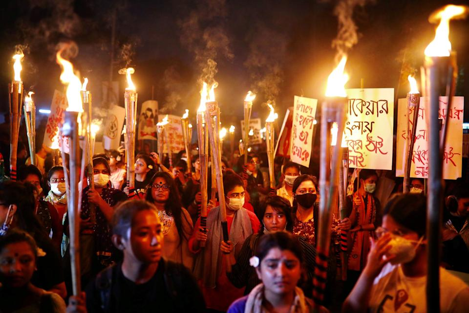 Women in Dhakha, Bangladesh, take part in a torch procession demanding women's safety and justice for rape victims on October 14, 2020. (Photo: Mohammad Ponir Hossain / Reuters)