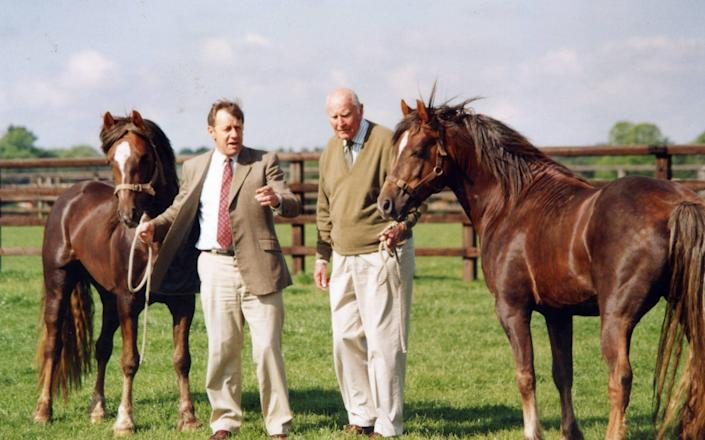Allen, left, with twin foals and Peter Burrell, former director of the National Stud