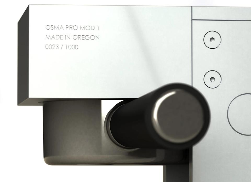 Close-up of the side of the Osma machine, with etched limited number.