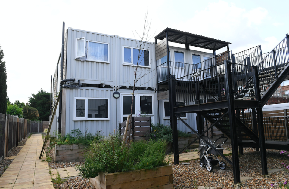 Thousands of children are growing up in converted shipping containers (PA)