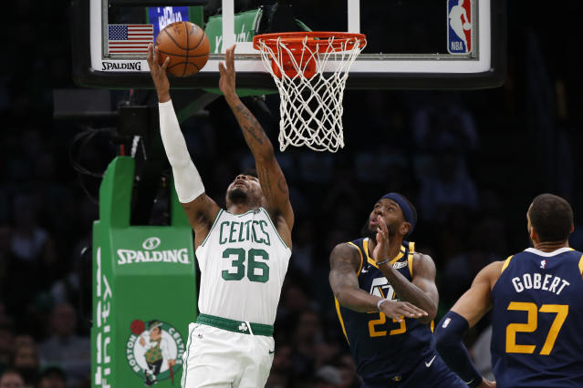 Boston Celtics' Marcus Smart (36) goes to the basket past Utah Jazz's Royce O'Neale during the first quarter of an NBA basketball game Friday, March 6, 2020, in Boston. (AP Photo/Winslow Townson)