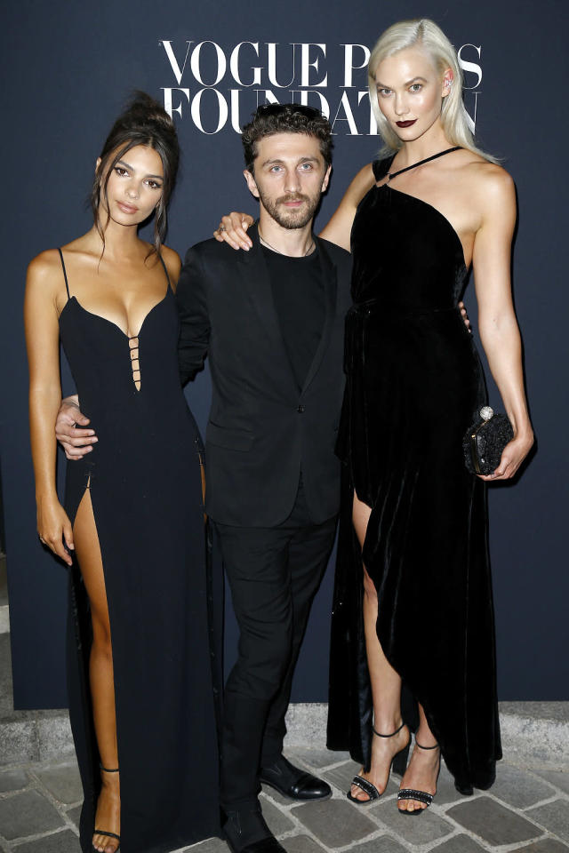 """<p>The models, who posed with designer David Koma, were anything but basic in their black dresses at the <i>Vogue</i> Paris Foundation Gala. As <a href=""""http://www.vogue.com/article/emily-ratajkowski-elizabeth-hurley-versace-safety-pin-dress-red-carpet-celebrity-style"""" rel=""""nofollow noopener"""" target=""""_blank"""" data-ylk=""""slk:the magazine noted"""" class=""""link rapid-noclick-resp"""">the magazine noted</a>, Ratajkowski's look was a nod to Elizabeth Hurley's famous <a href=""""https://www.yahoo.com/celebrity/elizabeth-hurley-turns-50-210102764.html"""" data-ylk=""""slk:safety-pin dress;outcm:mb_qualified_link;_E:mb_qualified_link"""" class=""""link rapid-noclick-resp newsroom-embed-article"""">safety-pin dress</a>. (Photo: Julien Hekimian/Getty Images for Vogue) </p>"""