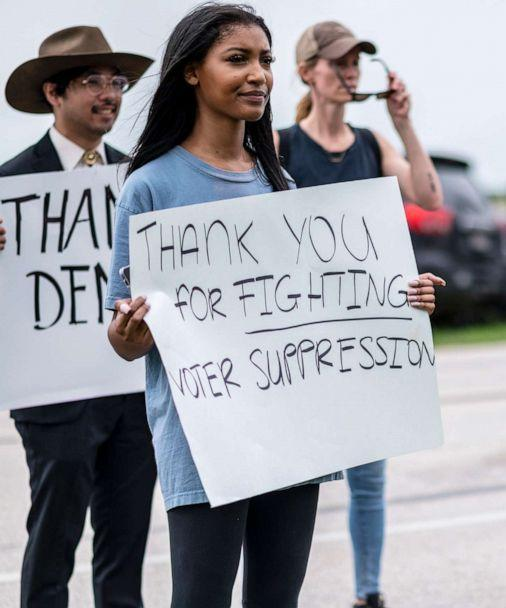 PHOTO: Supporters for Texas Democrats stand outside the Austin Bergstrom International Airport on July 12, 2021, in Austin, Texas. (Sergio Flores/Getty Images)