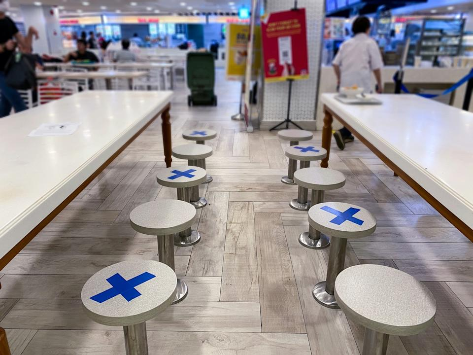 Social distancing rules in practice, alternate seating in local public food courts