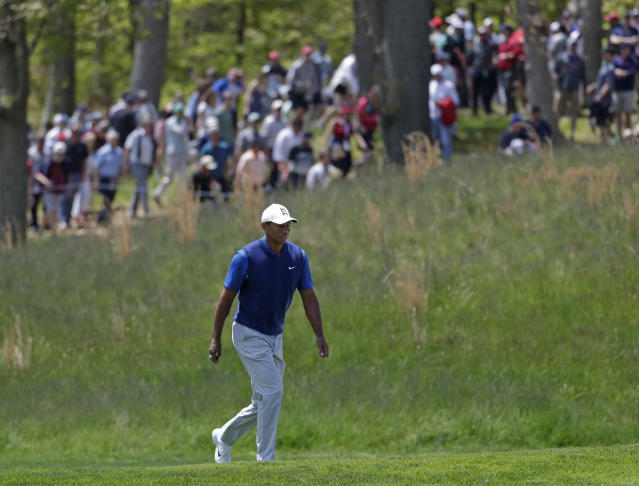 Tiger Woods walks the fifth fairway during the first round of the PGA Championship golf tournament, Thursday, May 16, 2019, at Bethpage Black in Farmingdale, N.Y. (AP Photo/Julio Cortez)