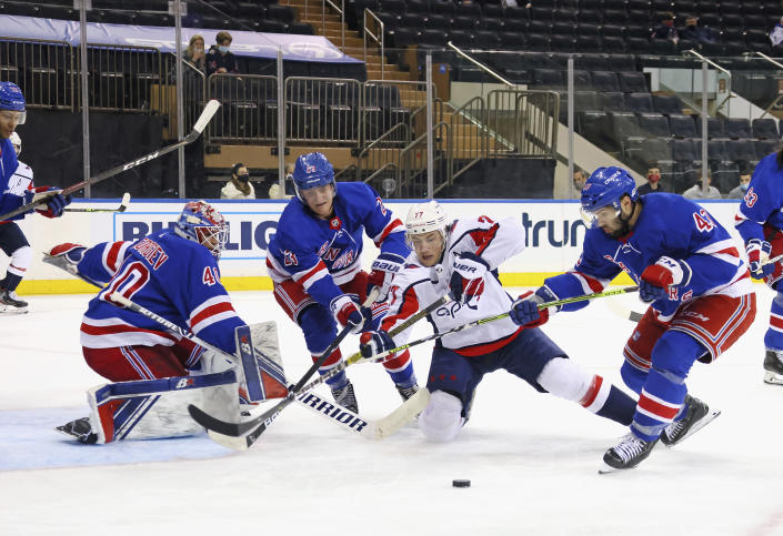 Washington Capitals' T.J. Oshie (77) is thwarted by the New York Rangers defense during the third period of an NHL hockey game Wednesday, May 5, 2021, in New York. (Bruce Bennett/Pool Photo via AP)