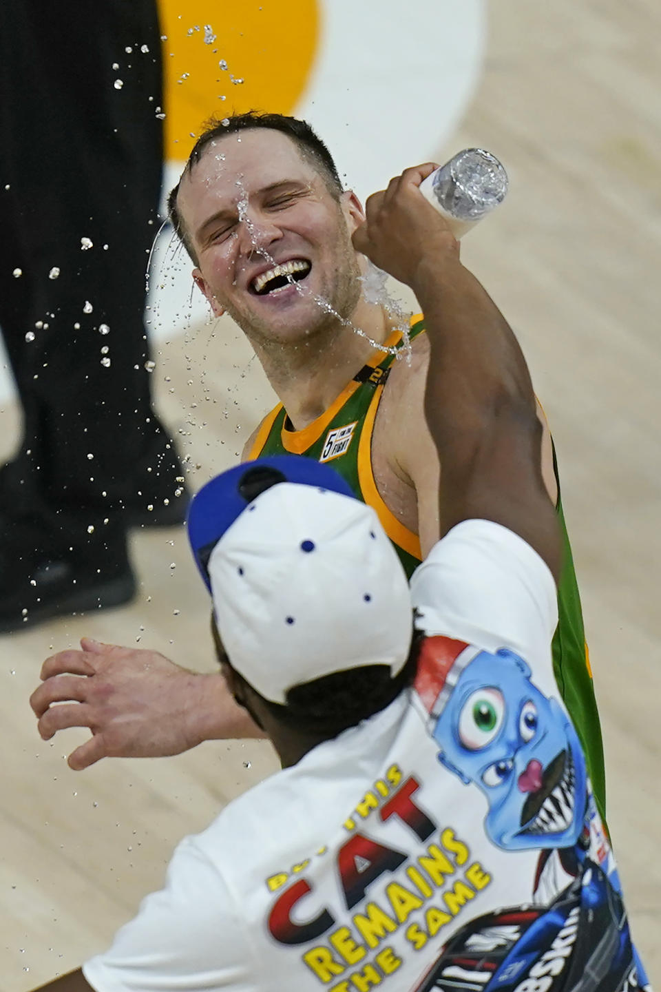 Utah Jazz guard Donovan Mitchell pours water over forward Bojan Bogdanovic as they celebrate the team's victory over the Denver Nuggets in an NBA basketball game Friday, May 7, 2021, in Salt Lake City. (AP Photo/Rick Bowmer)
