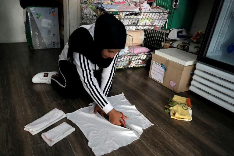 Employee Izdihar prepares sanitary pads from diapers at a charity store in Beirut