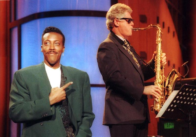"""FILE - In this June 3, 1992 file photo, Arkansas Gov. Bill Clinton, plays the saxophone as host Arsenio Hall stands by during a campaign stop on """"The Arsenio Hall Show"""" in Los Angeles. After two decades, Hall is returning to late night television with """"The Arsenio Hall Show,"""" premiering on Sept. 9. (AP Photo/Reed Saxon, File)"""