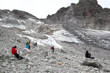 Hikers walk on a Pizol glacier, in Mels