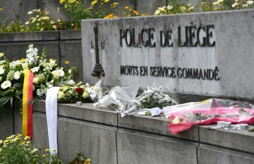 A picture taken on May 30, 2018 shows flowers that are laid in front of Liege police headquarters in tribute to victims of a shooting in Liege
