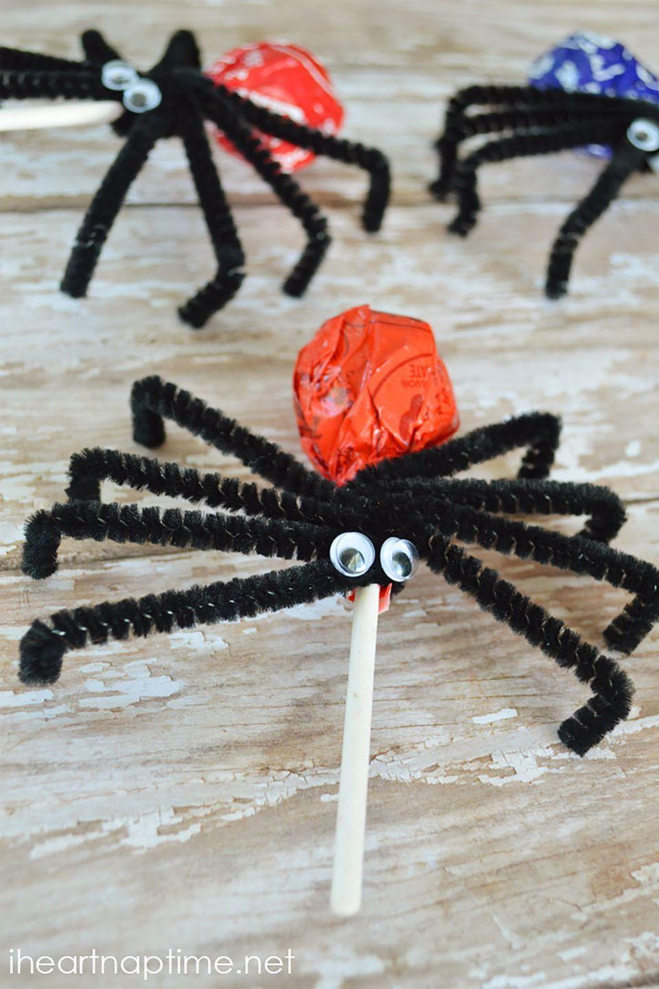 """<p>Lollipops get a scary twist dressed as creepy crawlers.</p><p><strong>Get the tutorial at <a href=""""https://www.iheartnaptime.net/spider-suckers/"""" rel=""""nofollow noopener"""" target=""""_blank"""" data-ylk=""""slk:I Heart Nap Time"""" class=""""link rapid-noclick-resp"""">I Heart Nap Time</a>. </strong> </p>"""