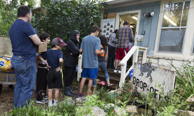 <p>A line forms to deliver rescued animals such as squirrels and birds to Austin Wildlife Rescue in east Austin Sunday, August 27, 2017. As Tropical Storm Harvey winds blow young and old squirrels out of the trees area residents bring the injured wildlife to the animal rescue center. (Photo: Stephen Spillman / for American Statesman) </p>