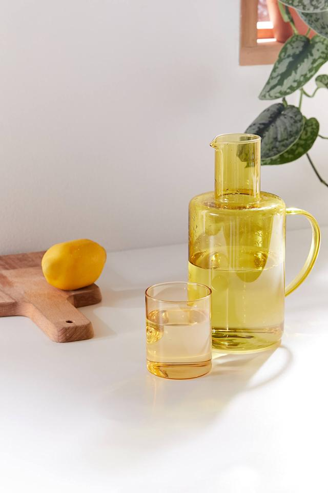 """<p>Stay hydrated with this <a href=""""https://www.popsugar.com/buy/Glass-Carafe-Set-560165?p_name=Glass%20Carafe%20Set&retailer=urbanoutfitters.com&pid=560165&price=24&evar1=casa%3Aus&evar9=47340777&evar98=https%3A%2F%2Fwww.popsugar.com%2Fhome%2Fphoto-gallery%2F47340777%2Fimage%2F47340783%2FGlass-Carafe-Set&list1=shopping%2Curban%20outfitters%2Ckitchen%20tools%2Ckitchen%20accessories&prop13=api&pdata=1"""" rel=""""nofollow"""" data-shoppable-link=""""1"""" target=""""_blank"""" class=""""ga-track"""" data-ga-category=""""Related"""" data-ga-label=""""https://www.urbanoutfitters.com/shop/glass-carafe-set?category=dinnerware&amp;color=030&amp;type=REGULAR"""" data-ga-action=""""In-Line Links"""">Glass Carafe Set</a> ($24).</p>"""