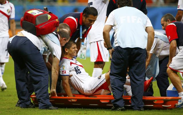 Costa Rica's Cristian Gamboa is carried off the pitch, to be substituted by Costa Rica's Dave Myrie, during the 2014 World Cup quarter-finals between Costa Rica and the Netherlands at the Fonte Nova arena in Salvador July 5, 2014. REUTERS/Paul Hanna (BRAZIL - Tags: SOCCER SPORT WORLD CUP)