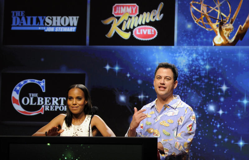 """Comedian Jimmy Kimmel, right, reacts alongside fellow presenter Kerry Washington after """"Jimmy Kimmel Live!"""" was nominated for Outstanding Variety Series during the nominations for the 64th Primetime Emmy Awards at the Academy of Television Arts & Sciences in Los Angeles, Thursday, July 19, 2012. The 64th annual Primetime Emmy Awards will be presented Sept. 23 at the Nokia Theatre in Los Angeles, hosted by Kimmel and airing live on ABC. (Photo by Chris Pizzello/Invision/AP)"""