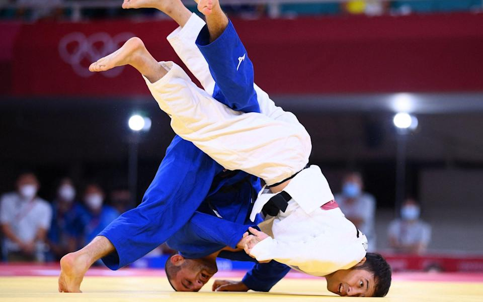Japan's Naohisa Takato (white) competes with Georgia's Lukhumi Chkhvimiani during their judo men's -60kg quarterfinal bout - GETTY IMAGES