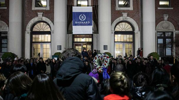 PHOTO: Students gather at the entrance of Barnard College in New York City during a vigil held for slain 18-year-old Tessa Majors on Dec. 12, 2019, (Jeenah Moon/Getty Images)