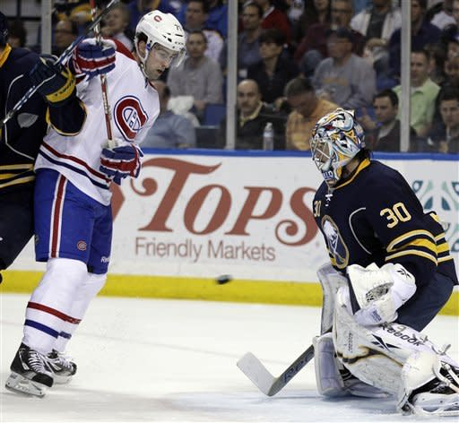 Montreal Canadiens' Louis Leblanc (71) looks for the puck in front of Buffalo Sabres goalie Ryan Miller during the second period of an NHL hockey game in Buffalo, N.Y., Wednesday, March 21, 2012. (AP Photo/David Duprey)