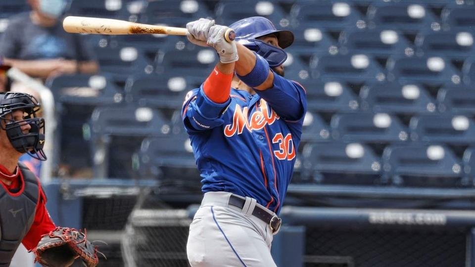 Michael Conforto follows through on a homer during spring training March 21 2021, close crop