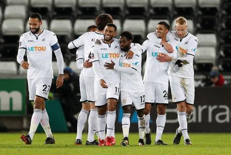 Soccer Football - FA Cup Fourth Round Replay - Swansea City vs Notts County - Liberty Stadium, Swansea, Britain - February 6, 2018 Swansea City's Kyle Naughton celebrates scoring their fifth goal with team mates Action Images via Reuters/Matthew Childs
