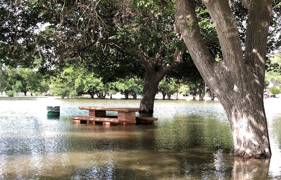 A large portion of Eastwood Park, better known as Album Park, was still covered by water Monday after a massive thunderstorm Sunday dumped rain across El Paso.