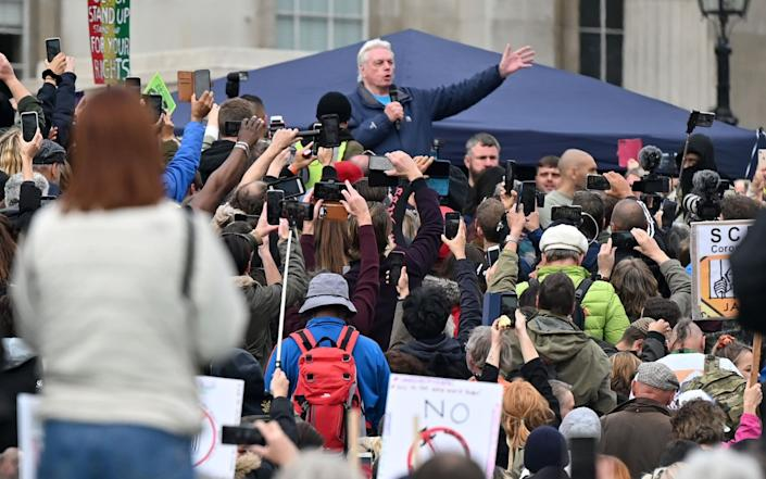 Conspiracy theorist David Icke enjoying a warm reception at the protests - AFP