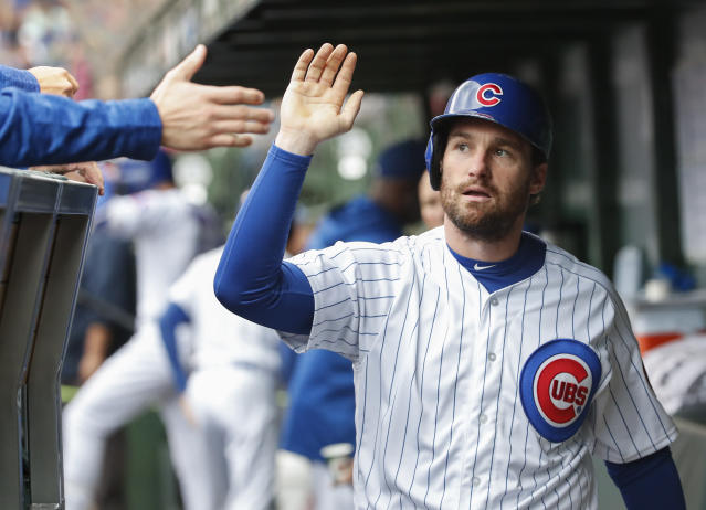 Chicago Cubs' Daniel Murphy celebrates with teammates in a dugout after scoring against the St. Louis Cardinals during the first inning of a baseball game, Friday, Sept. 28, 2018, in Chicago. (AP Photo/Kamil Krzaczynski)