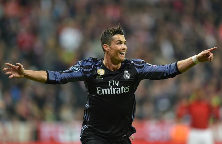 Real Madrid's forward Cristiano Ronaldo reacts after scoring during the UEFA Champions League 1st leg quarter-final football match against Bayern Munich April 12, 2017