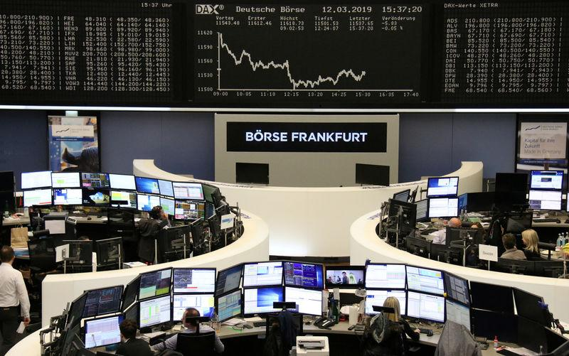 FILE PHOTO: The German share price index DAX graph is pictured at the stock exchange in Frankfurt, Germany, March 12, 2019. REUTERS/Staff
