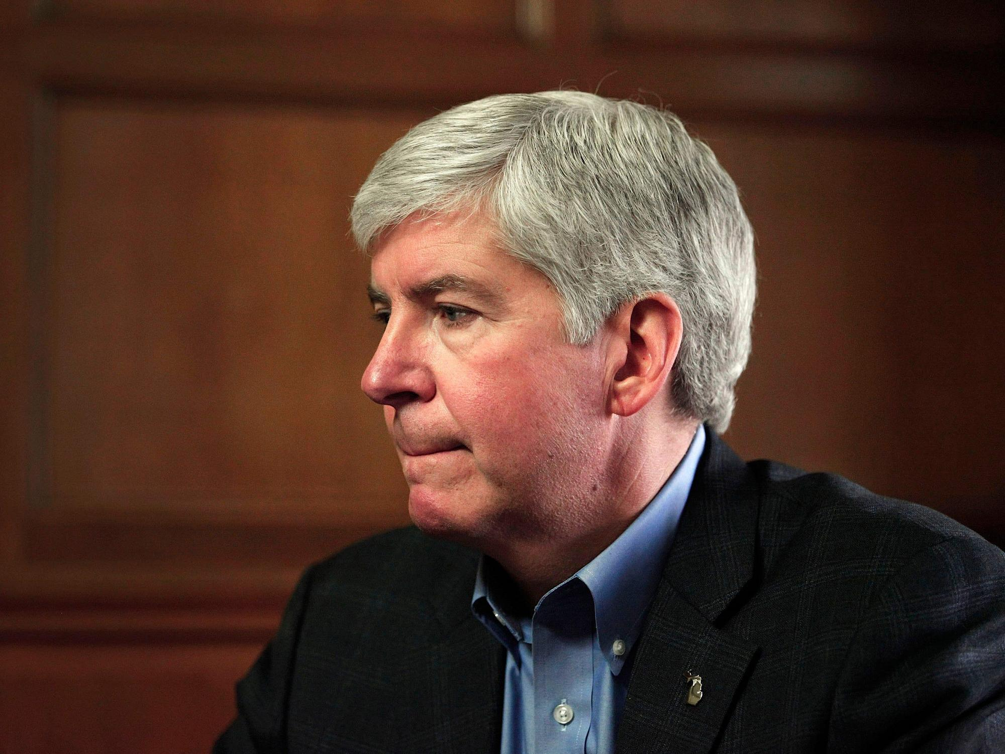 Former Michigan Gov. Rick Snyder has been criminally charged with willful neglect in connection with the Flint water crisis, report says
