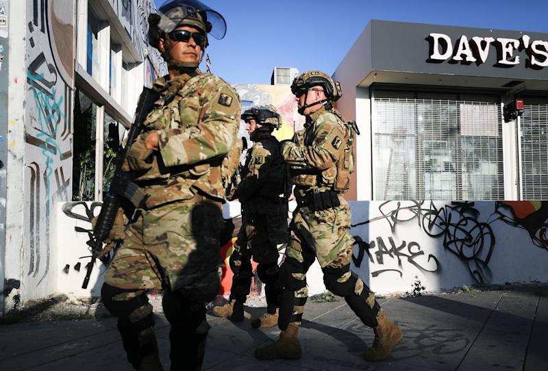 On May 31, 2020, U.S. National Guard troops patrol in L.A.'s Fairfax District, which was damaged during unrest the day before. The troops were called in by California Gov. Gavin Newsom following violent demonstrations in response to George Floyd's death.
