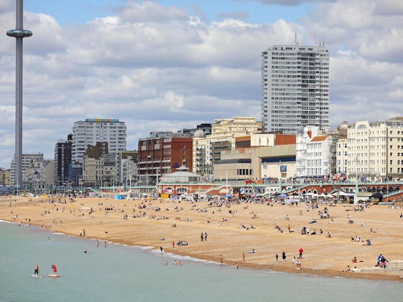 People enjoy the sun at the beach in Brighton on 11 July, 2020: Aaron Chown/PA Wire