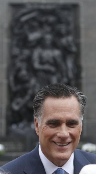 Republican presidential candidate and former Massachusetts Governor Mitt Romney visits the Monument to the Ghetto Heroes in Warsaw, Poland, Tuesday, July 31, 2012 (AP Photo/Czarek Sokolowski)