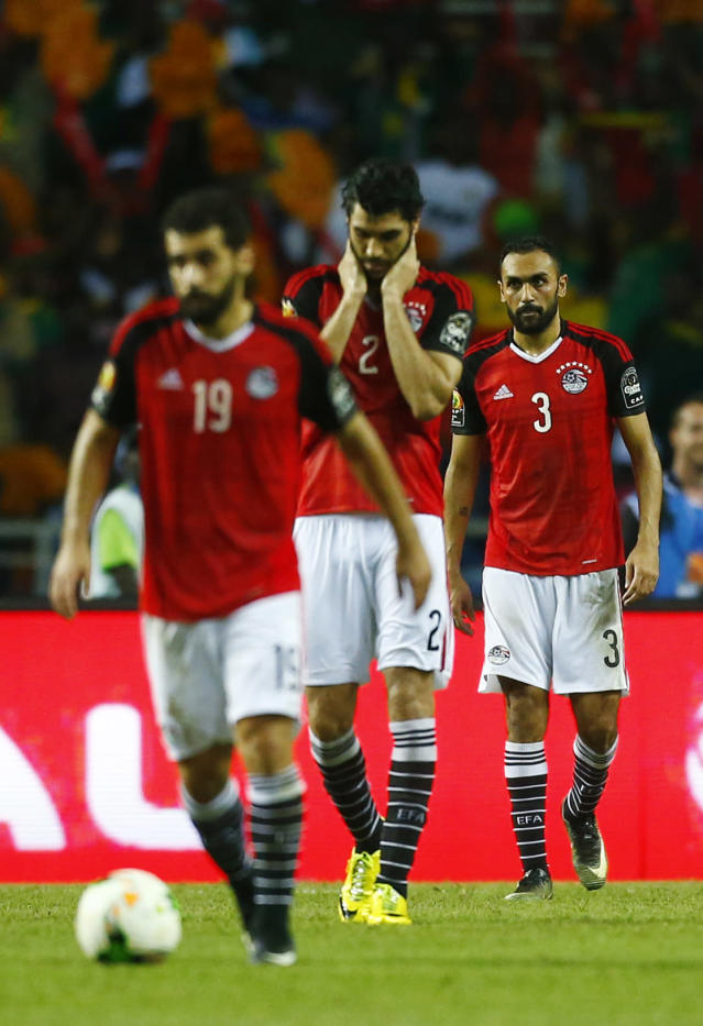 Football Soccer - African Cup of Nations - Final - Egypt v Cameroon - Stade d'Angondjé - Libreville, Gabon - 5/2/17 Egypt's Ali Gabr and Ahmed Elmohamady look dejected after Cameroon's Vincent Aboubakar scores their second goal Reuters / Amr Abdallah Dalsh Livepic
