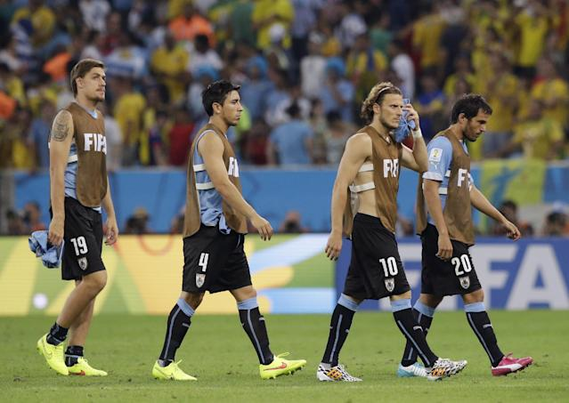 Uruguay's Diego Forlan (10) and his teammates leave the pitch following Colombia's 2-0 victory over Uruguay during the World Cup round of 16 soccer match between Colombia and Uruguay at the Maracana Stadium in Rio de Janeiro, Brazil, Saturday, June 28, 2014. (AP Photo/Matt Dunham)