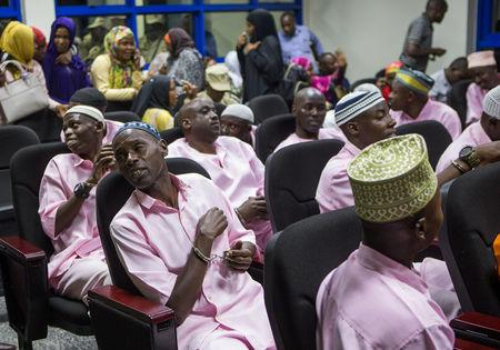 Unidentified suspects are seen inside the Rwandan high court after being convicted of belonging to extremist groups including al Shabaab and Islamic State and providing them support, in Nyanza, Rwanda March 22, 2019. REUTERS/Jean Bizimana