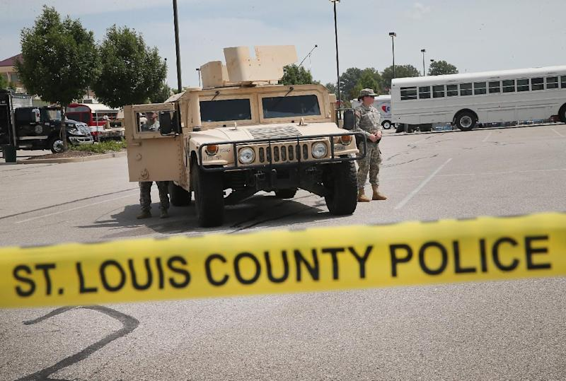 Military police with the Missouri Army National Guard stand guard at the police command center which was established to direct security operations following unrest after the recent death of Michael Brown on August 21, 2014 in Ferguson (AFP Photo/Scott Olson)