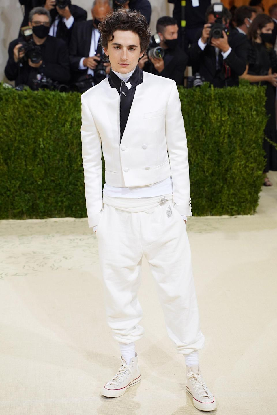 Hollywood's golden boy and 2021 Met Gala co-host Timothée Chalamet looked like a modern-day prince in his Haider Ackermann tuxedo. He dressed down his swanky look with a humble pair of Converse Chuck Taylors – an American classic. You might love or hate his eclectic mix, but there's no denying that he nailed the theme!