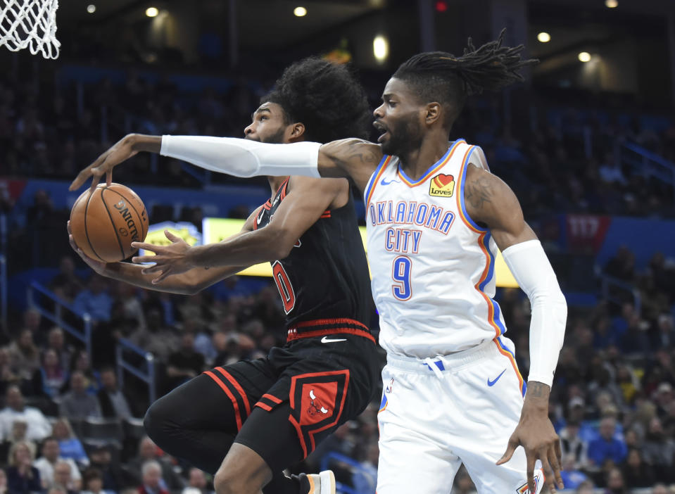 Oklahoma City Thunder forward Nerlens Noel tries to block a shot by Chicago Bulls guard Coby White in the first half of an NBA basketball game, Monday, Dec. 16, 2019, in Oklahoma City. (AP Photo/Kyle Phillips)
