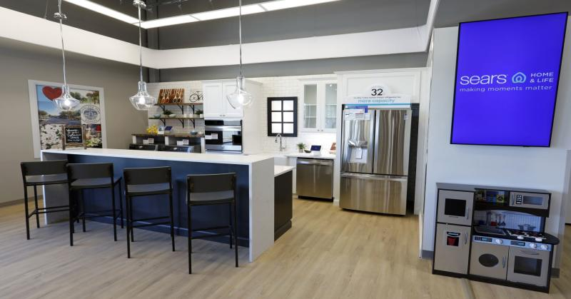 At the Sears Home & Life store, customers can browse leading appliance brands, including Kenmore, and assorted smart home products in kitchen vignettes.