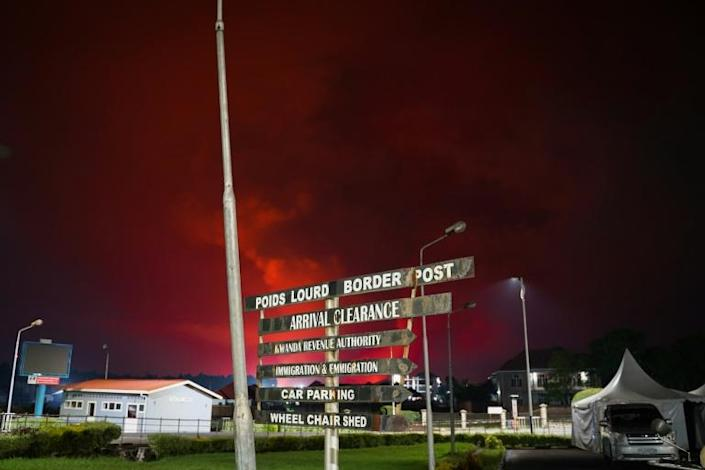 The red sky from the Nyiragongo volcano in DR Congo seen from the border at Gisenyi, Rwanda
