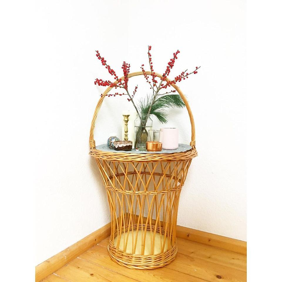 """<p>For a quaint touch to any room, consider this basket side table. Whether you place it directly next to a sofa or off in the corner of the room, it's bound to make a statement.</p><p><strong>See more at <a href=""""https://www.instagram.com/p/B5XlxbwIYD2/"""" target=""""_blank"""">@sustainablefox</a>. </strong></p><p><a class=""""body-btn-link"""" href=""""https://www.amazon.com/New-Star-Foodservice-50820-Aluminum/dp/B00EAXW772/?tag=syn-yahoo-20&ascsubtag=%5Bartid%7C10050.g.31152821%5Bsrc%7Cyahoo-us"""" target=""""_blank""""><strong>SHOP METAL TRAY</strong></a></p>"""